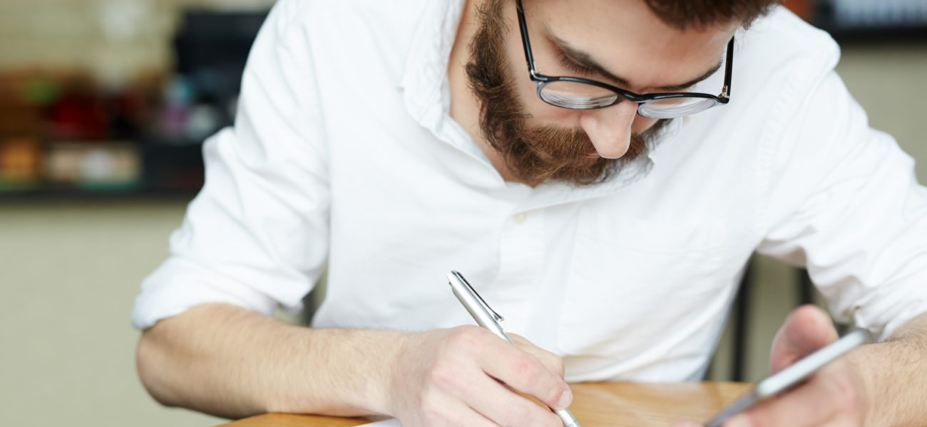 Young applicant reading contract given by employer before signing it